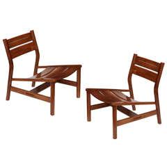 Pierre Gautier-Delaye, Pair of oak lounge chairs, France, c. 1950