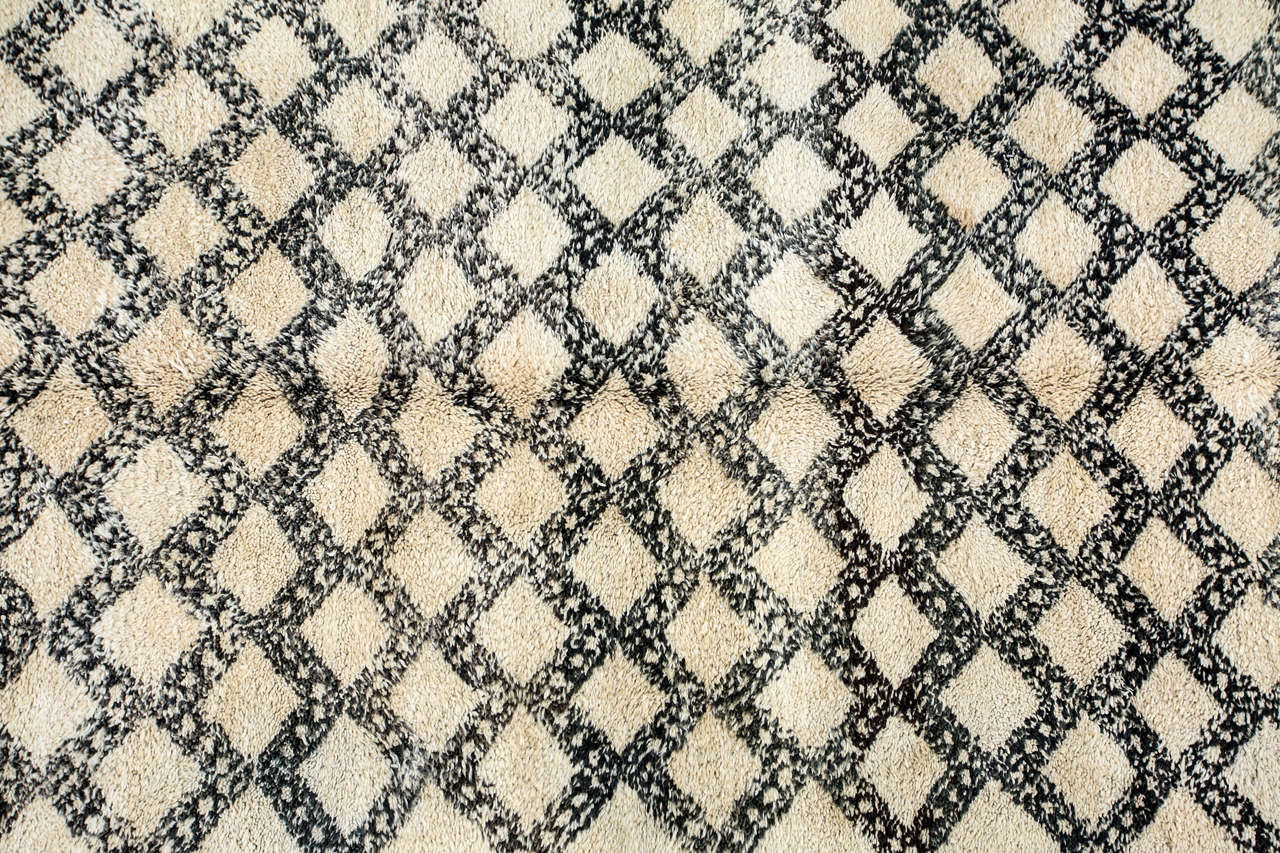 Moroccan shaggy and lush Berber rug from the Beni Ouarain tribes from the middle atlas mountains of Morocco.  Vintage Very nice shaggy soft lush lamb-wool carpet handwoven with organic un-dyed ivory wool with asymmetrical diamond shape designs in