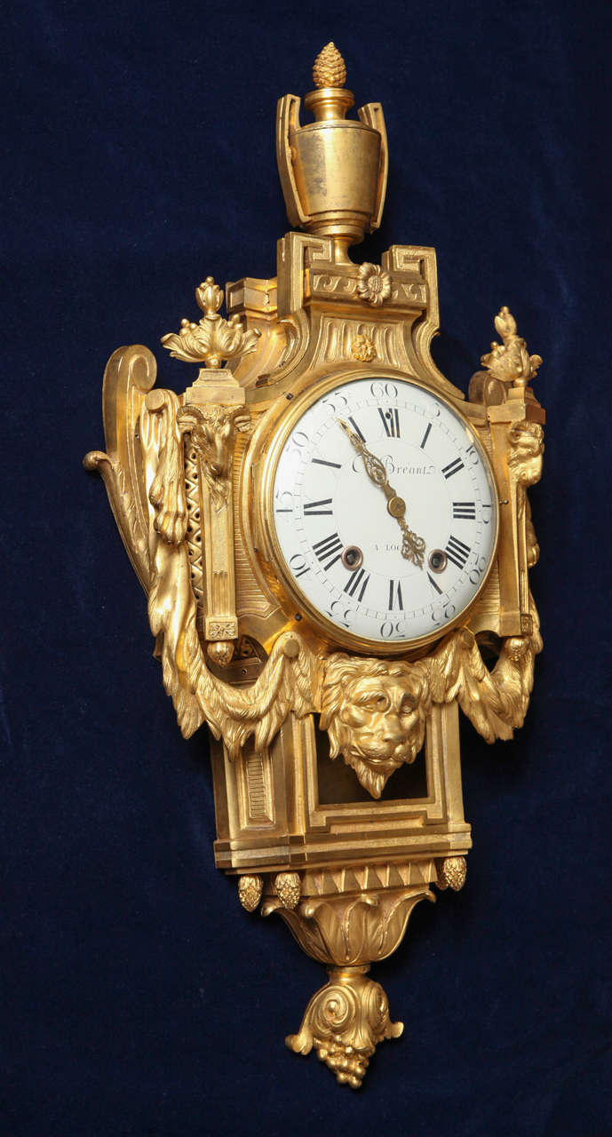 Antique French Louis XVI period dore bronze striking cartel clock, 18th century. With it's horological functions completely intact this stunning clock is in excellent condition with it's original pendulum. An urn perches atop the structure with