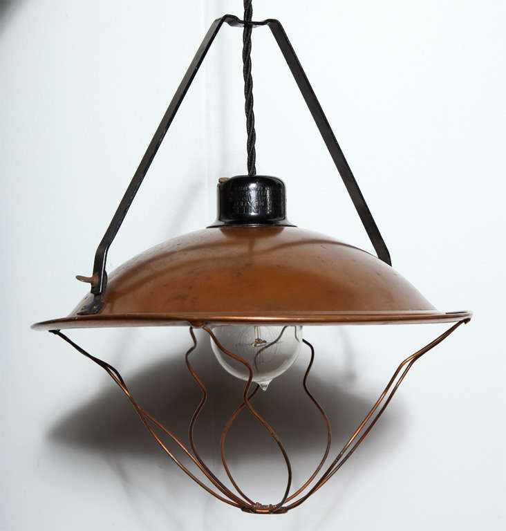 Adjustable All Copper Hanging Pendant, Circa 1920's.  Featuring a solid Copper Shade, Copper bulb protector and standard ceramic socket. Swag.