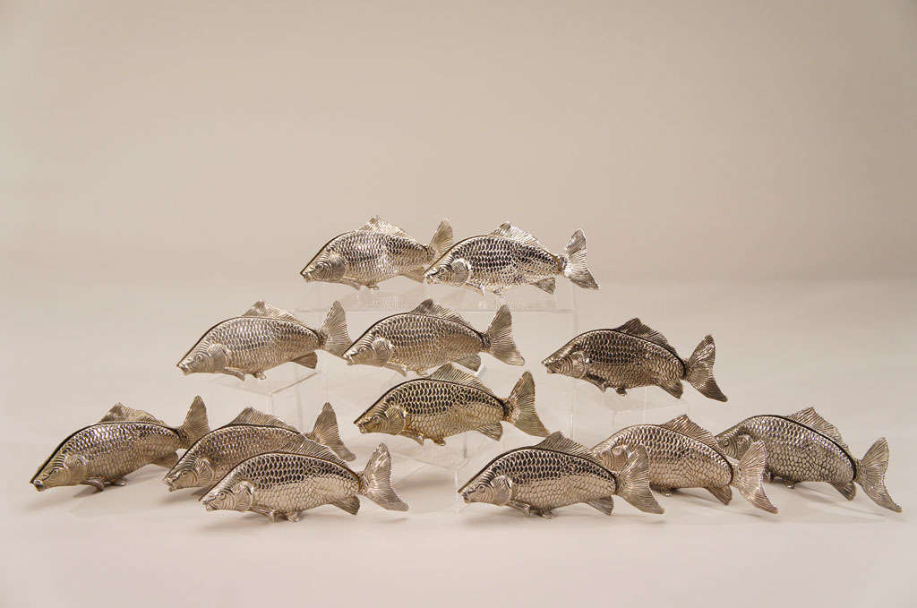 Set of 12 imaginative figural fish sculptures depicting swimming carp. These unusual large swimming fish have an elongated slot in which to place either a menu or perhaps a designation for a table number. These could be used in a restaurant or