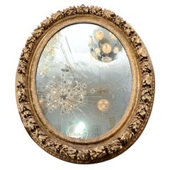 19th Century French Carved Wood and Gold Gilded Gesso Oval Mirror
