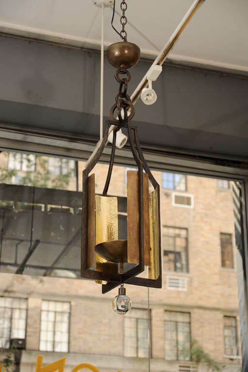 Contemporary bronze lantern with a hanging crystal ball by Hervé van der Straeten.