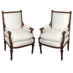 Pair 19th c. Louis XVI French Walnut Fauteuils with Down Cushion