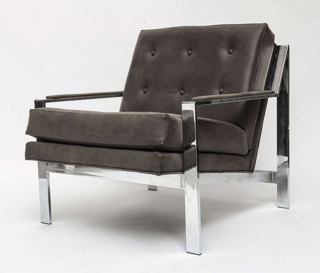 Chrome lounge chair by Cy Mann with new