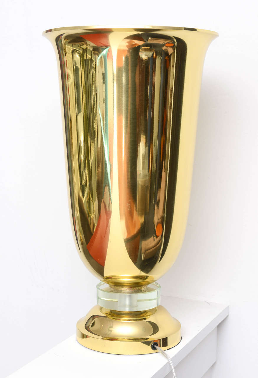 Full Art Deco period, table lamp. Brass and crystal, tulip shaped designed . Round circle crystal base supporting the body of the piece . Diameter of the base is 7