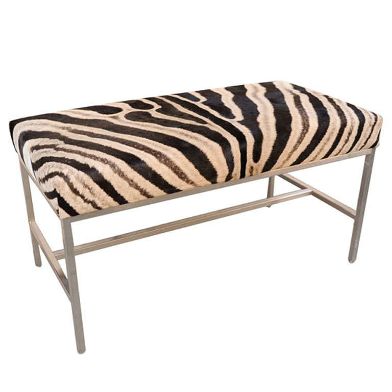 african zebra skin ottoman with polished chrome legs at