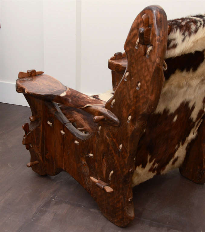 Pair of Pinewood and Cowhide Armchairs by Georges Charpentier 8
