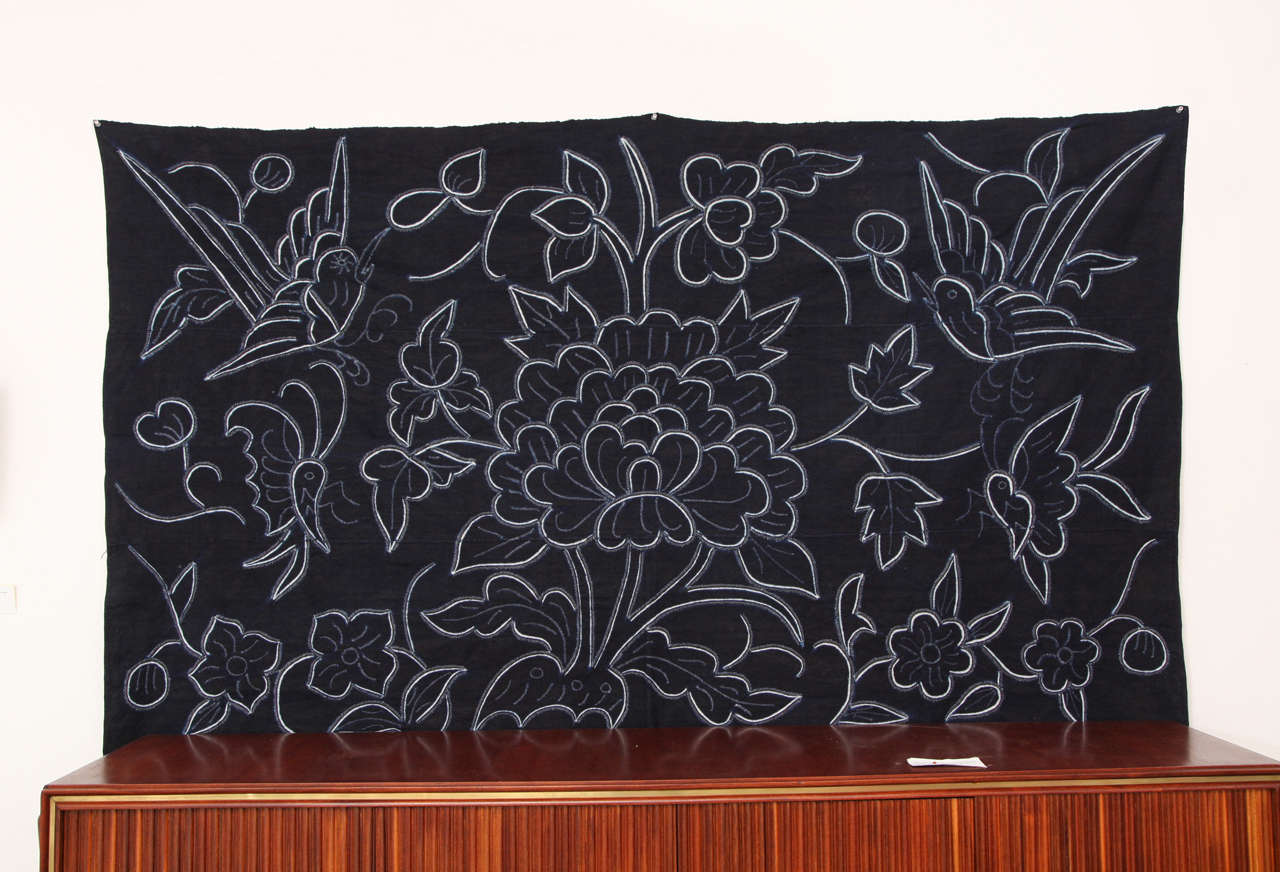 Indigo textile wall decoration tapestry with decorative flowers in white by Chinese Bouyei people, circa 1980.