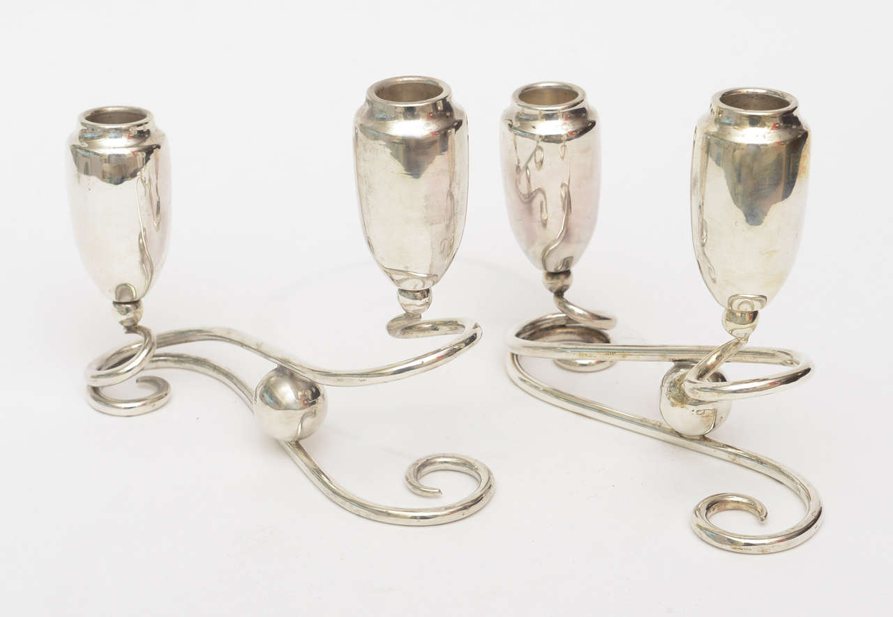 These lovely and elegant pair of sterling silver unmarked candlesticks have the ball motif and can be placed in so many different configurations on any table. They are both modern in look and period in time.
