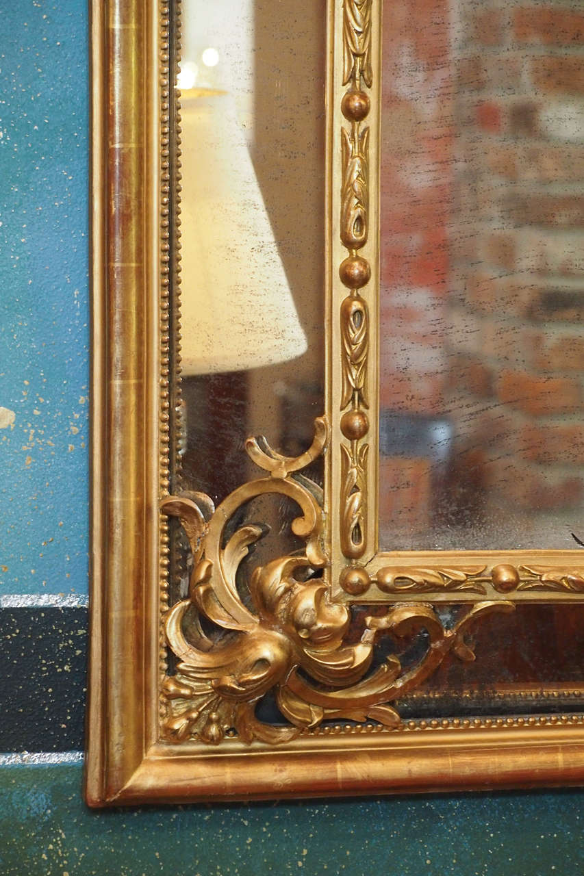 Antique French gold leaf Louis XV style cushion mirror w ...