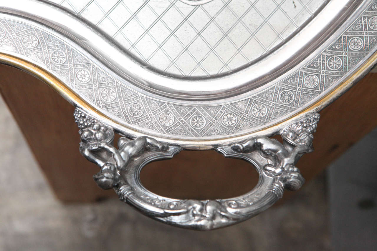 Silver Plated Butler Tray with Articulated Cherub Handles In Good Condition For Sale In Culver City, CA