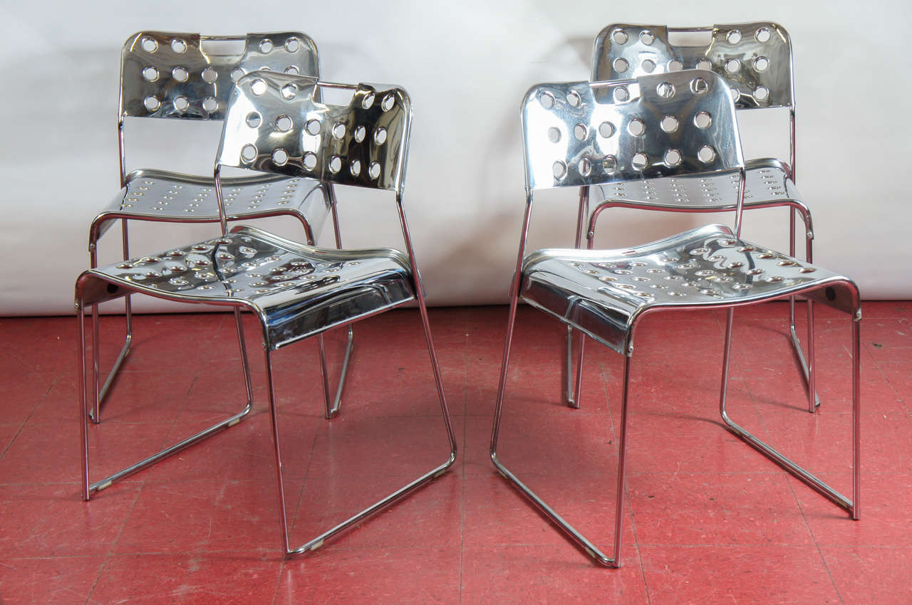 Four sleek Rodney Kinsman for Bieffelplast Omstak stacking chairs.  Grid patterned metal seat and backs in chrome.  Very comfortable with curved angled back.