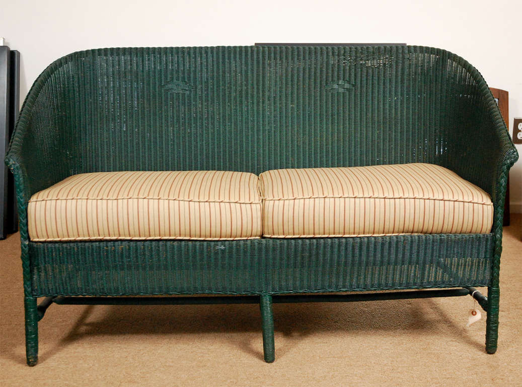 A good 3 piece set of American, circa the 1930's, wicker furniture. Comprising of a 30 1/2 h x 52wide x 24d settee along with an arm chair and a rocker, both matching in construction methods and finish. Items may be purchased as one lot or