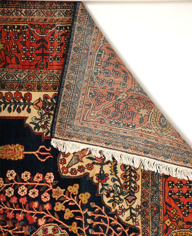 This Persian Sarouk Fereghan carpet created, circa 1880 consists of a cotton warp and weft, hand-knotted pure wool pile and organic vegetal dyes. It is an exceptionally elegant piece and its size is indicative of its role as a