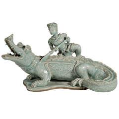 Celadon Sculpture of a Warrior and Alligator