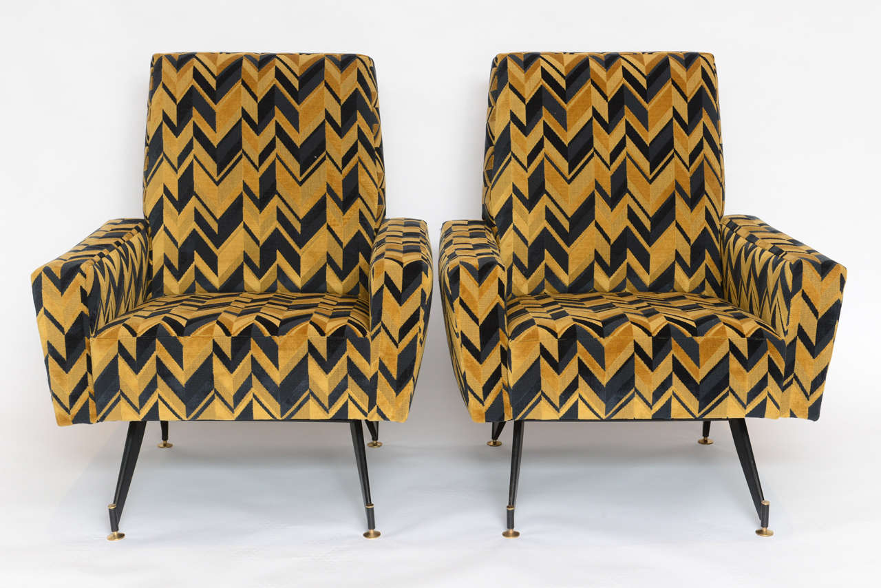 Very sculptural, the legs alone make a bold statement. The velvet fabric on era design adds to their bold look.