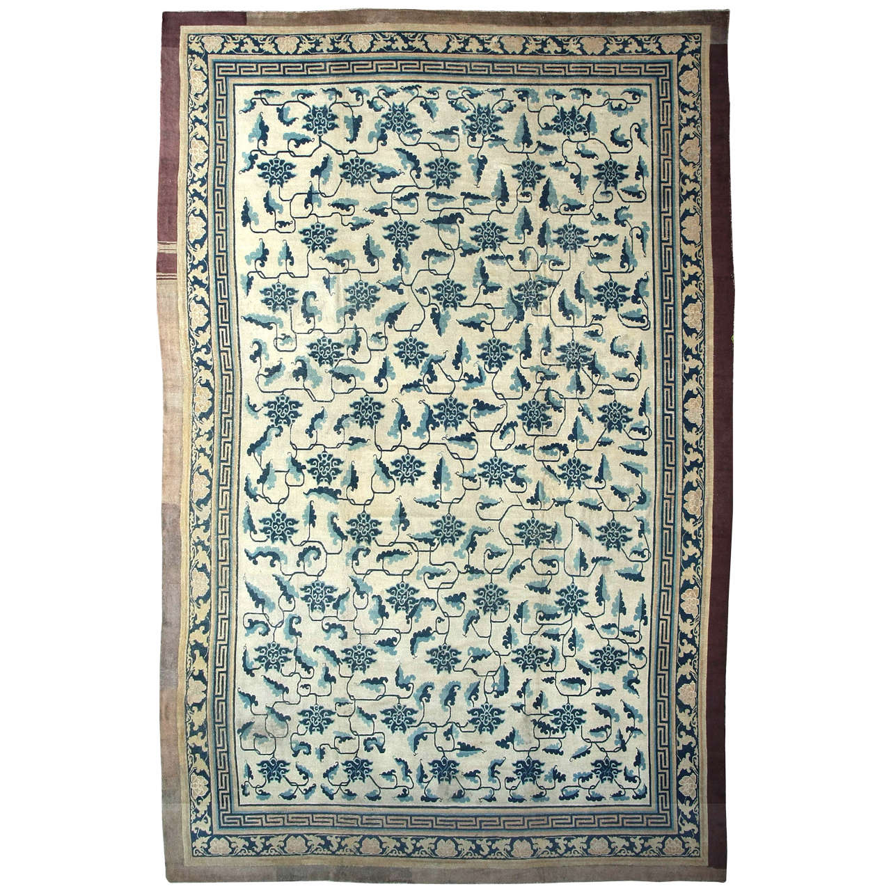 Early Chinese Carpet with Stylized Lotus Flowers and Leaf Stems