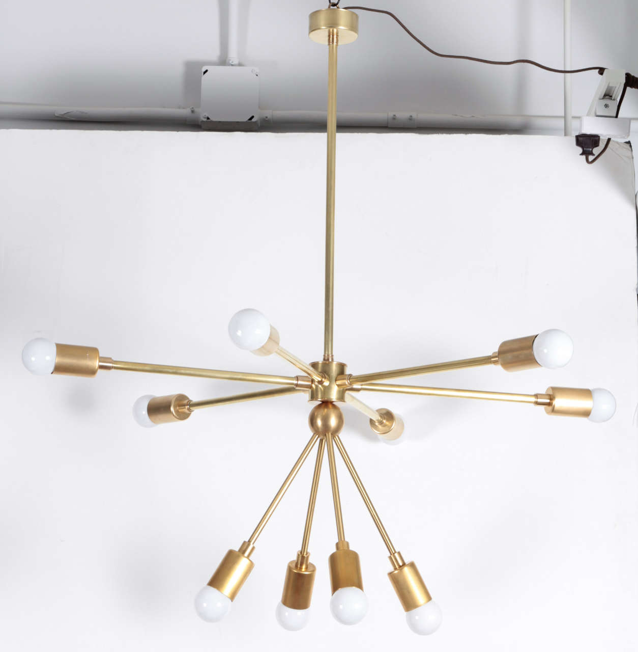 The Macomber Sputnik-style light fixture. USA, new production. Features six horizontal arms and four downward arms. Polished brass. This is a custom item; available ready made in dimensions provided below or as a custom piece with 2 to 4 week