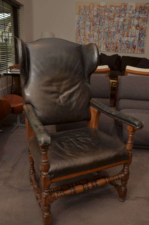 This antique fauteuil Malade has aged black leather and black nail heads along the trim. Chair has a reclining feature with three settings.  Patinated black leather.  Measures: Seat height 18
