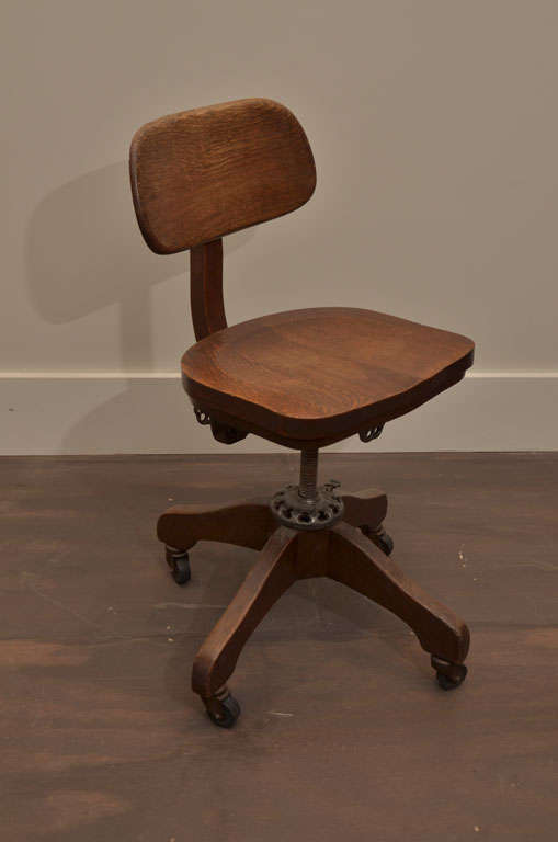 Vintage wooden task chair on casters with swivel base.  Measures: Seat height 20.5