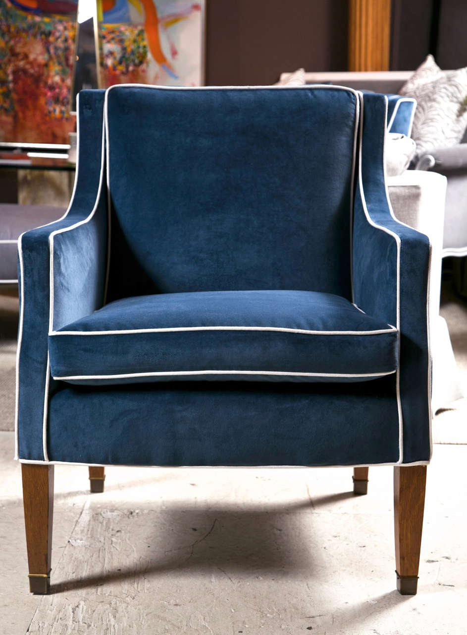 Mid Century Club Chairs With Blue Velvet Upholstery And White Piping.