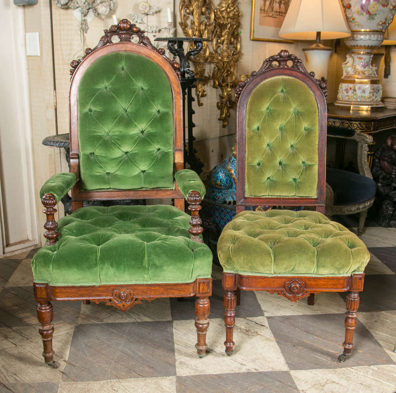 This set comprises two armchairs and six side chairs. The oak frames are hand-carved and decorated with nuts and fruits. The turned front legs have casters. The side chairs are smaller in proportion to the arm chairs. The dimensions given are of the