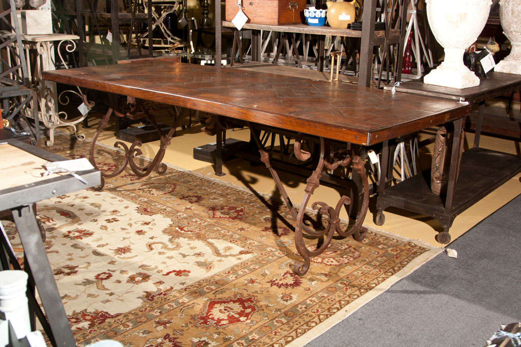Good American Wrought Iron Base Wood Top Dining Table For Sale