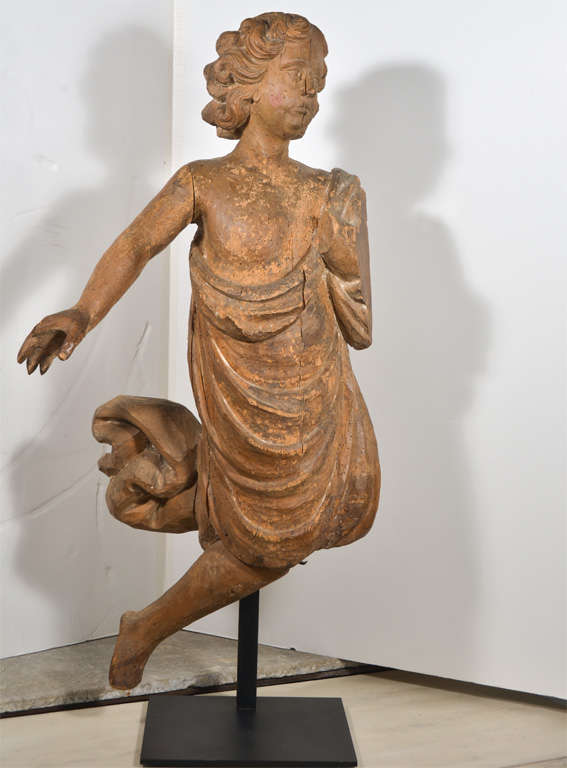 Carved wooden angel from Private Chapel in Provence. Wonderful detail in Angel's hair and draped dress. Figure is mounted on an iron stand.