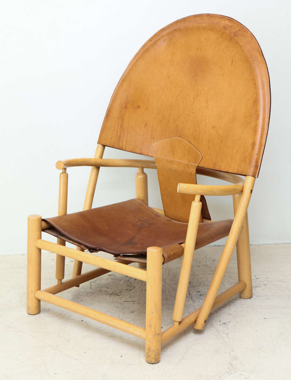 Rare leather and beech hoop chair by Borge Mogensen.  Denmark, circa 1950.