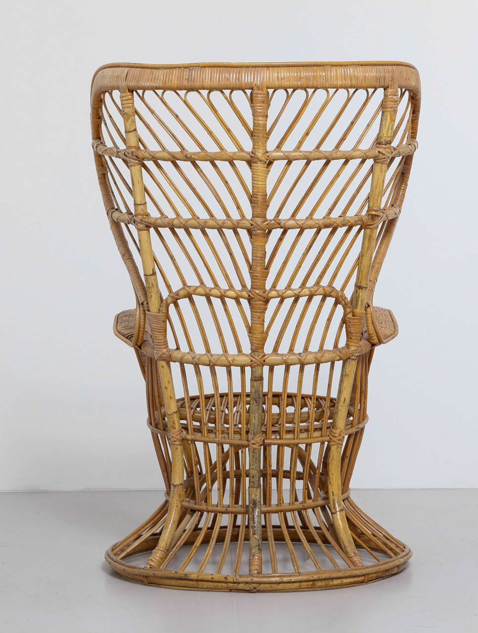 High Rattan Wingback Chair Designed by Lio Carminati and