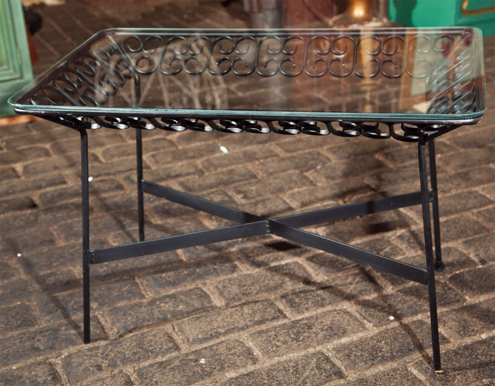 Small wrought iron side table from the Grenada collection designed by Arthur Umanoff and manufactured by Boyuer Scott Company.