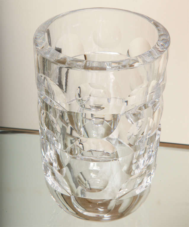 This heavy, signed and modernist stunning crystal Orrefors glass vase has incised half and full circles alternating patterns.  It is signed Mona Morales Schildt. It is elegant and modern, and perfect for your favorite flowers! Classic! It must be