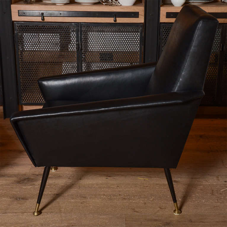 Sleek and sexy pair of 1960's italian club chairs newly upholstered in black leather