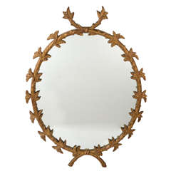 Provincial Style Gilt Wood Oval Mirror with Laurel Leaf Design