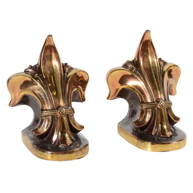 Pair of fleur de lis crest bookends in cast bronze and Fleur de lis bookends
