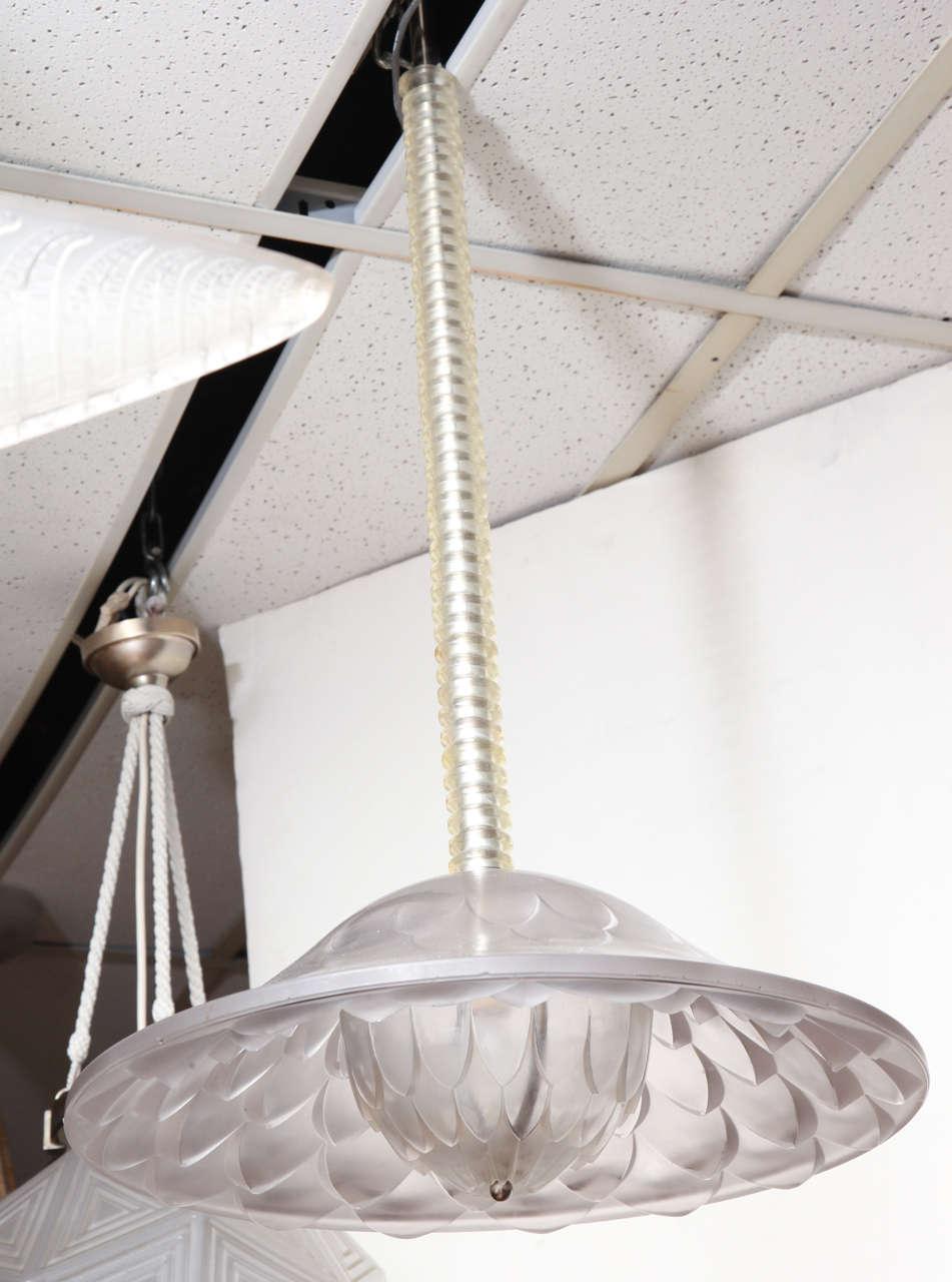 """A rare """"Verone"""" chandelier by Rene Lalique, designed in 1927, comprised of multiple glass elements, molded with a floral """"Dahlias"""" motif. Diameter 16"""", adjustable art. Ref. """"R. Lalique Catalogue Raisonne de l'oueuvre de verre"""" by F. Marcilhac, pg."""