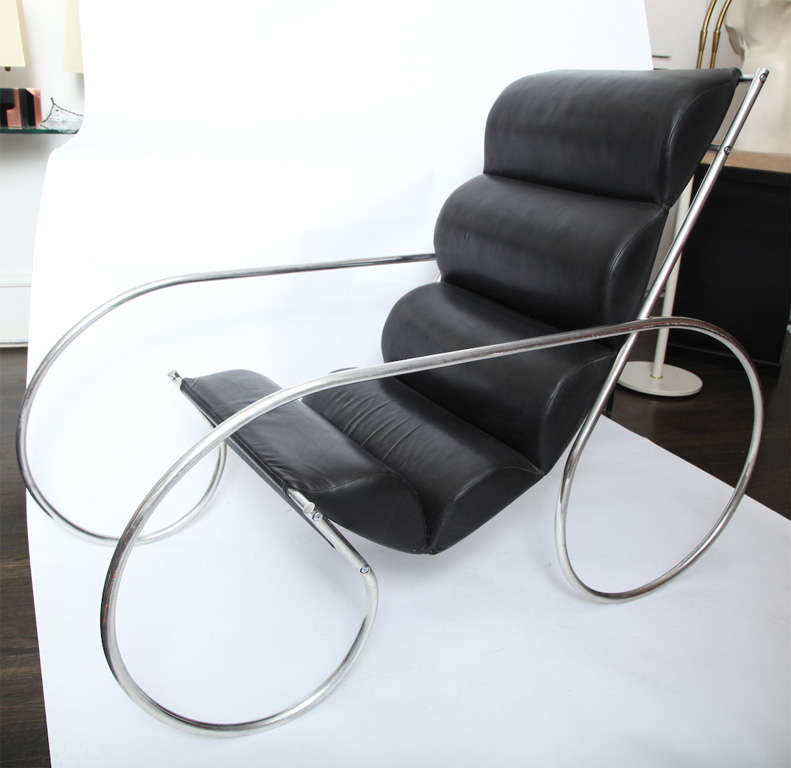 An American modernist polished aluminium and leather lounge chair and ottoman.