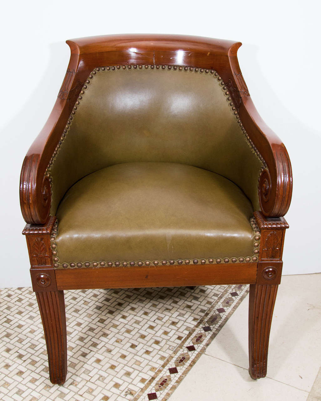 Regency Leather Upholstered Mahogany Tub Chair With Boldly Scrolled Arm  Terminals And Reeded Sabre Legs Ending