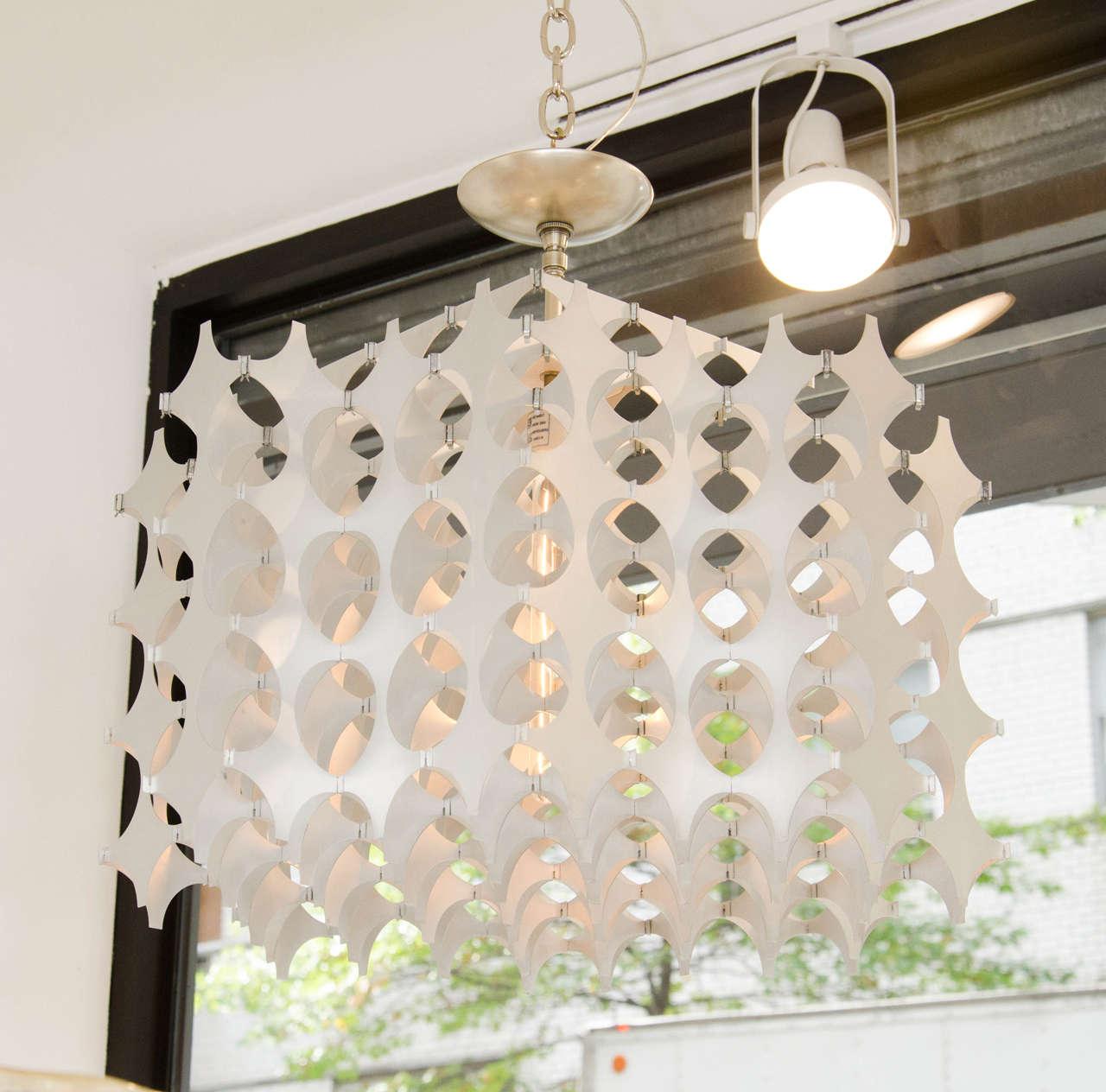 Geometric pierced aluminum pendant ceiling fixtures by Mario Marenco for Artemide.