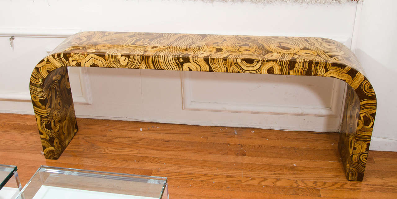 Hand-painted faux wood motif waterfall console table.
