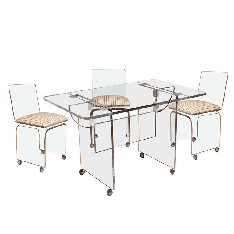 lucite dining gaming table and set of four lucite swivel chairs at