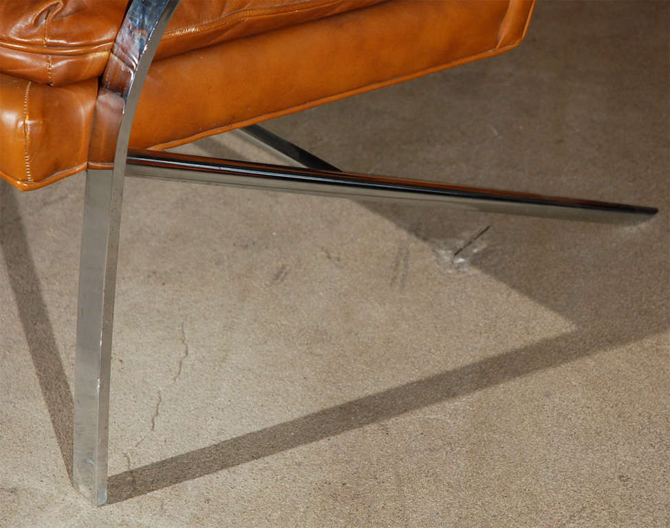 Lounge chair in the style of Paul Tuttle, late 20th century, with a cantilevered frame of chrome-plated steel and chrome.