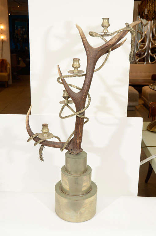 Outrageous and fantastic pair of antler candelabra wrapped in a thick twisted metal rope with wire tassel ends on stacked silver plate platform bases. Minimal wear to bases.