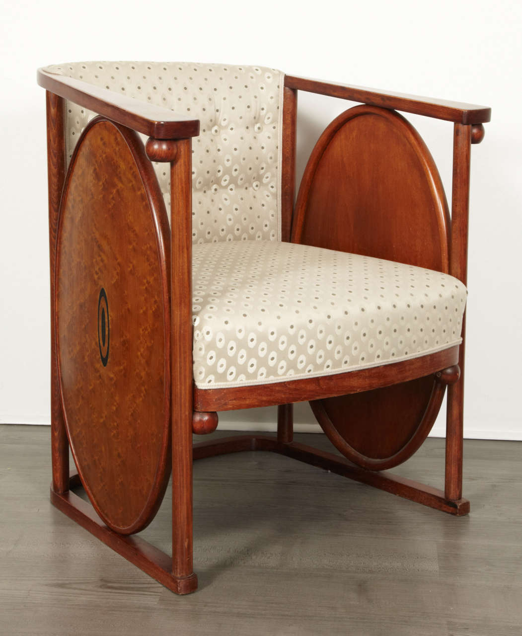 Koloman Moser (1868-1918) and Josef Hoffmann (1870-1956). Bent and polished beech and plywood, dyed to rosewood, brass inlays, renewed upholstery. Measures: Height 70 cm (27.5 in.), width 73 cm (28.7 in.), depth 66 cm (26 in.).