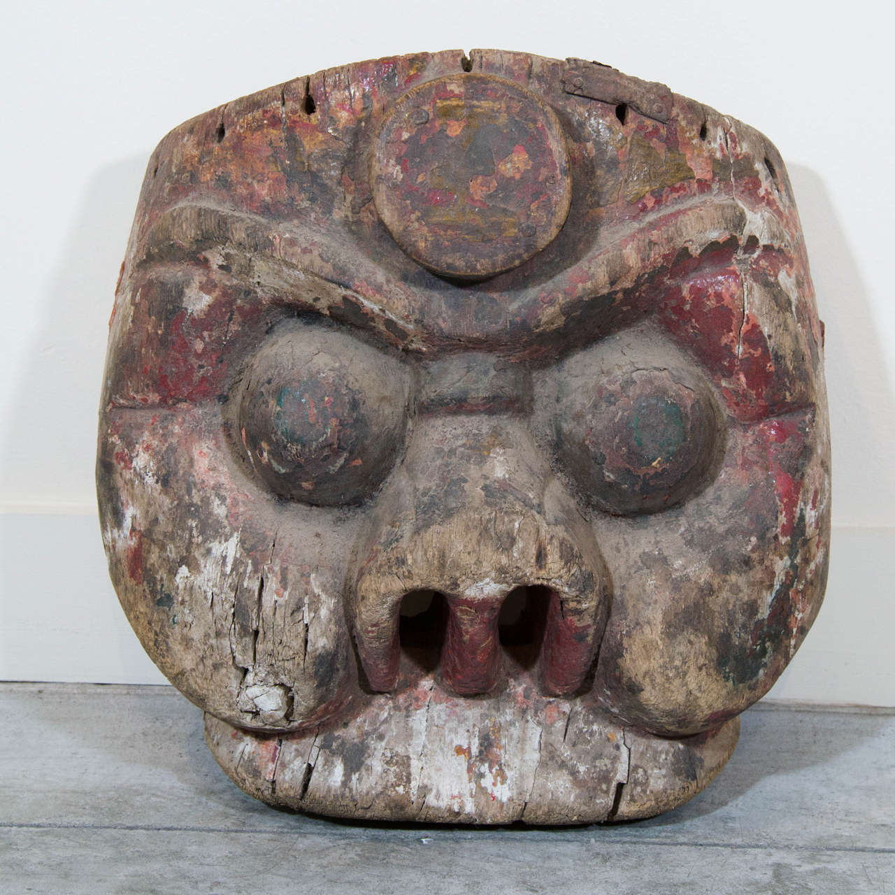 A beautifully carved early 19th Century Chinese mask with traces of original color. From Hunan Province.