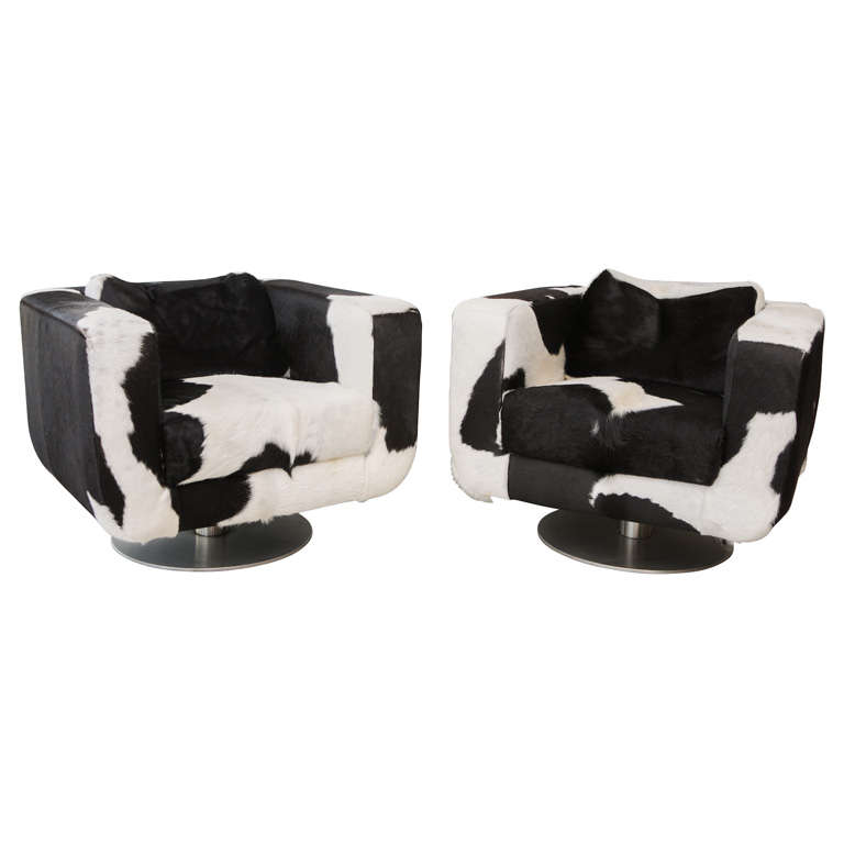Bon Pair Of Black And White Cowhide Swivel Chairs At 1stdibs