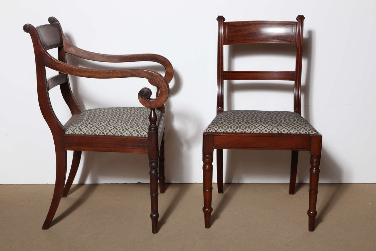 Set of Eight Early 19th Century English Regency Mahogany Dining Chairs Consisting of Two Armchairs And Six Side Chairs