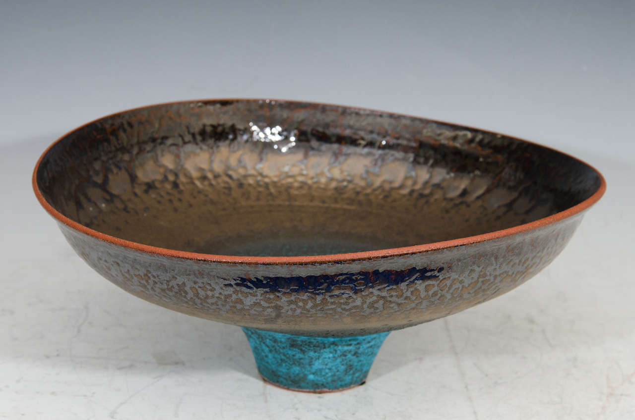 A spectacular Jeremy Briddell large tri-color pottery bowl with copper glaze.  Jeremy Briddell grew up in St. Louis Missouri but has lived in Pennsylvania, Kansas City, Omaha Nebraska and for the last 17 years Arizona. He did his undergraduate