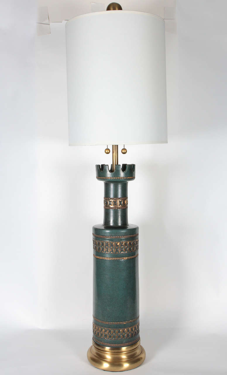 Fantastic stately pair of jade green ceramic lamps with stampato details on satin brass bases by Marbro. Lamps have been rewired and feature double pull chain sockets. Lamp body measures 24.75 inches.